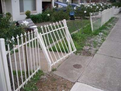 Repaired damaged front fence - before